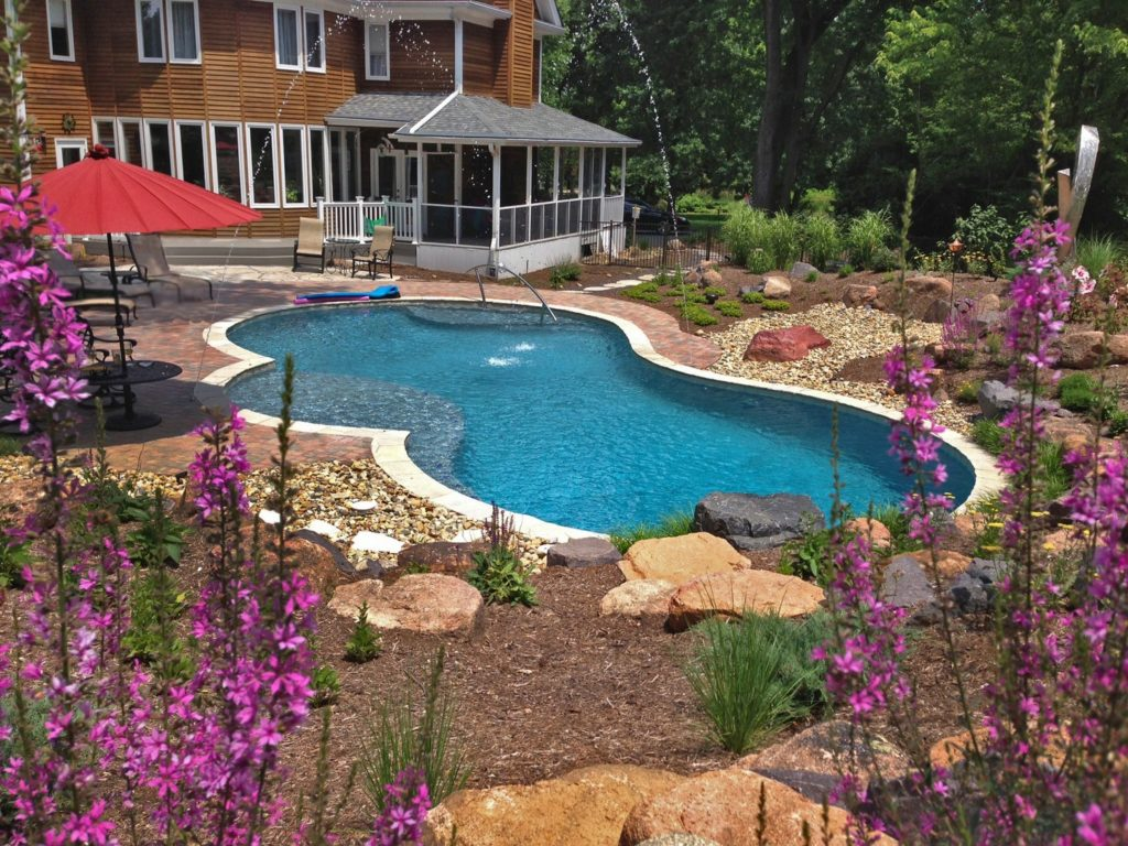 Transform your backyard into an outdoor oasis with liquid for Garden oasis pool